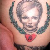 В тюрьмах начали набивать татуировки Юлии Тимошенко