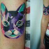 Татуировка кота на руке