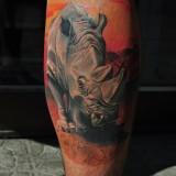 Тату носорога на ноге