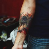 Татуировка собаки на руке