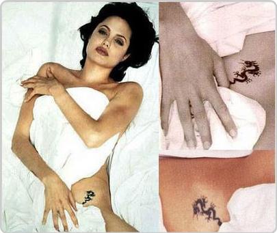 """татуировки Анджелины Джоли, Blue Tongue Dragon, Cross & """"Quod Me Nutrit Me Destruit"""""""