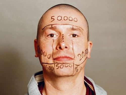 татуировки на лице Уве Трешель (3)