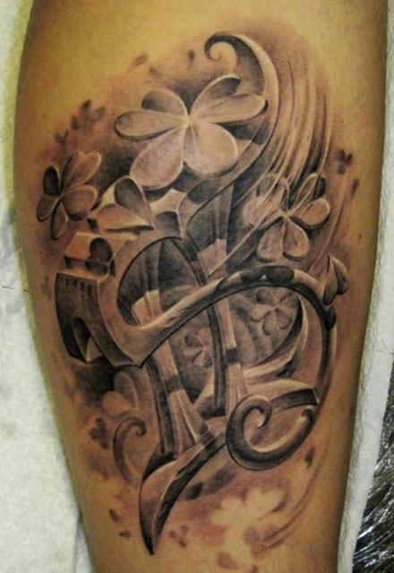 Татуировка знак зодиака на ноге