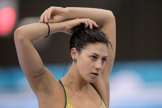 Трехкратная олимпийская чемпионка, рекордсменка на дистанциях 200 и 400 метров комплексным плаванием Стефани Райс тренируется в «Акватик-центре» Лондона. У нее как и у многих других спортсменов, выступающих на Олимпиаде-2012, вытатуированы на руке цветные Олимпийские кольца