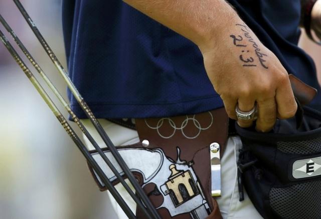 Стих из Библии на руке американского стрелка Брэди Эллисона