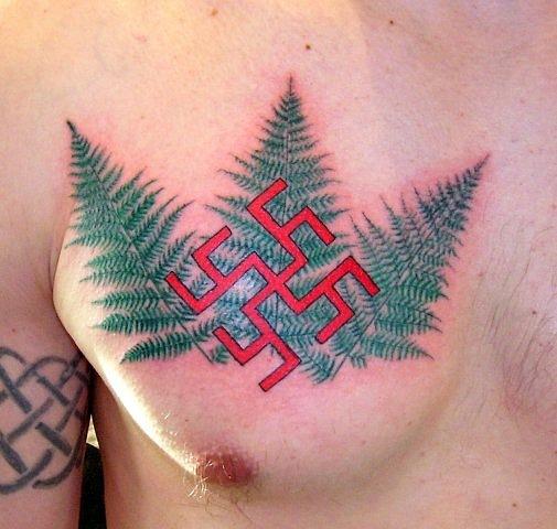 Татуировка свастика на мужской груди (19)