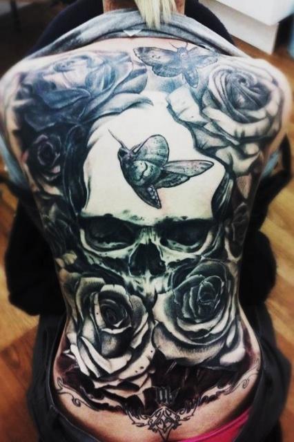 Татуировки черепов на спине