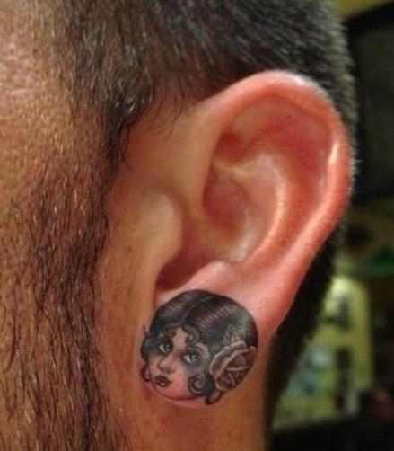 татуировки на ушах (6)