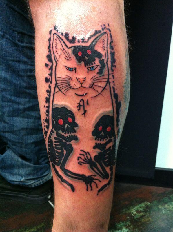 фото татуировка Кот со скелетами