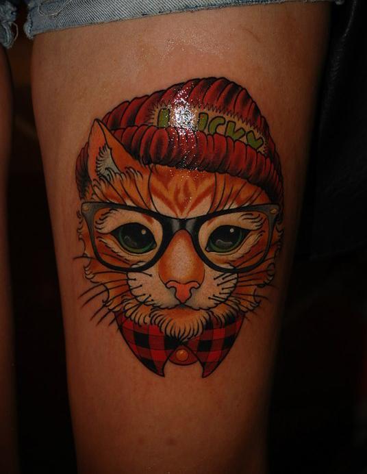 фото тату кот в очках