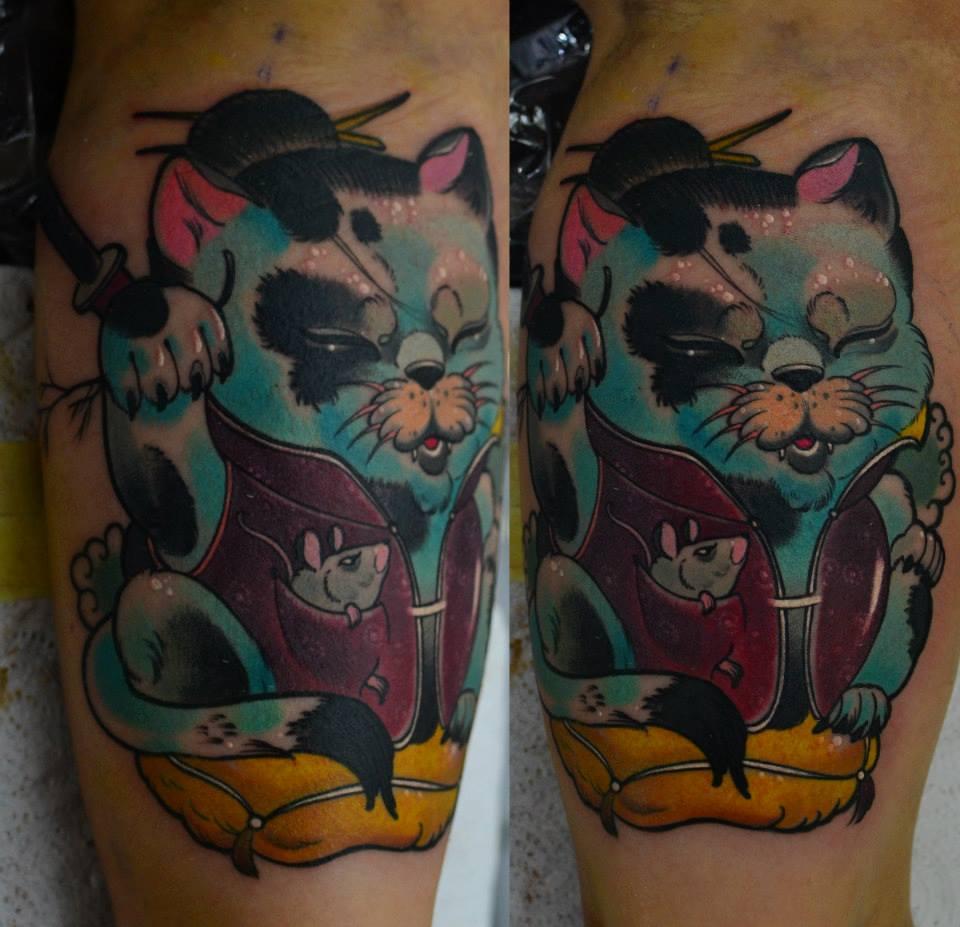 фото татуировки кота и мышонка