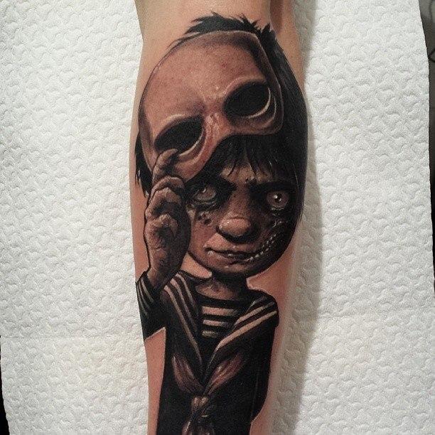 фото татуировки мальчика в маске